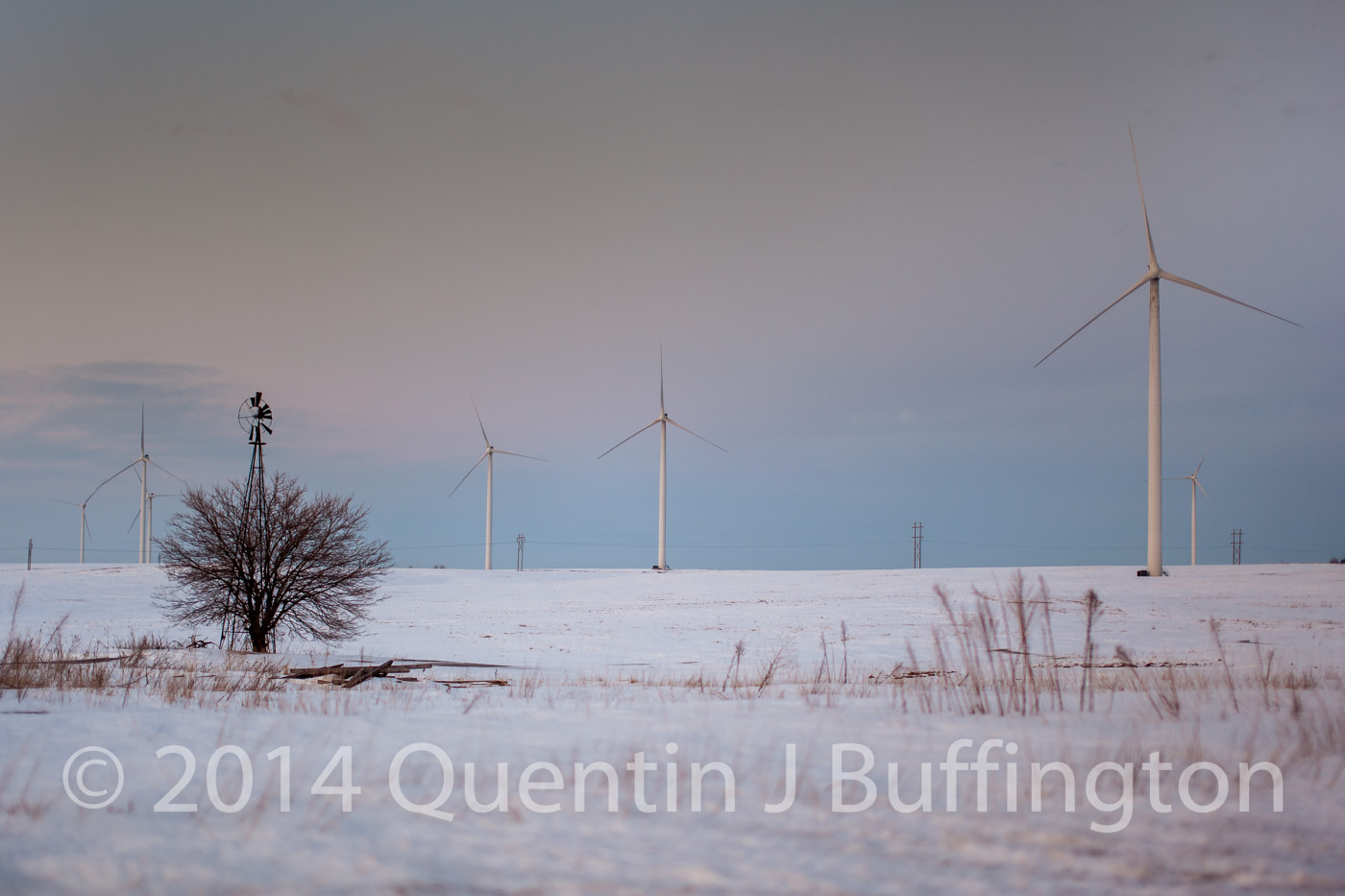 A blend of old and new windmills on the rolling hills of the Illinois Prairie.