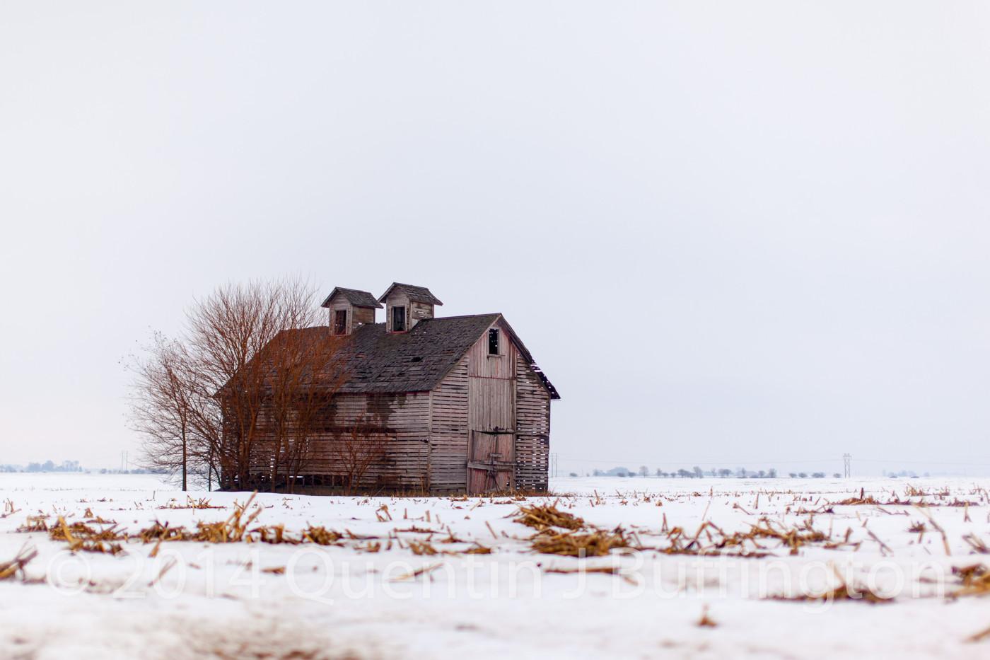 A faded red corn crib out near Leonore, Illinois