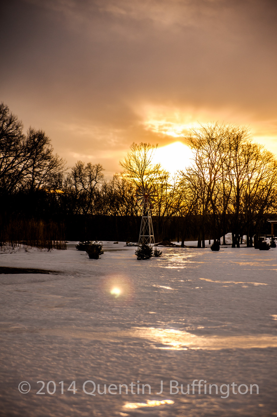 A late sunset shimmering off the ice and snow near Hennepin!