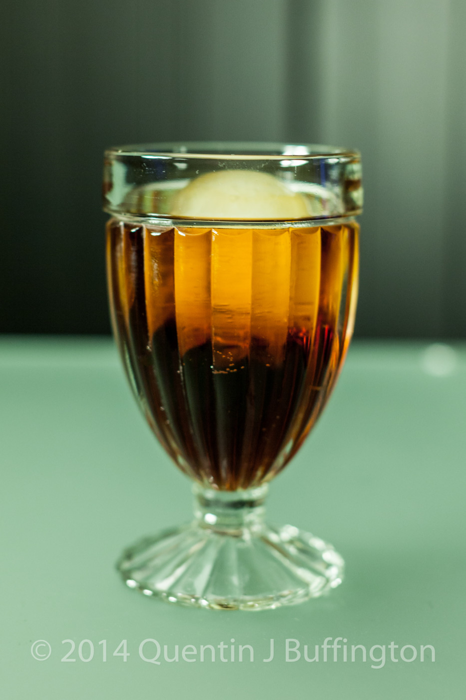 A cold glass of homemade root beer.