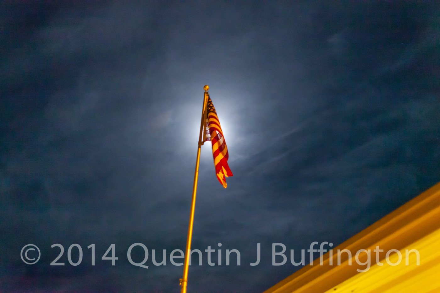 A moonlit flag with a slight breeze.